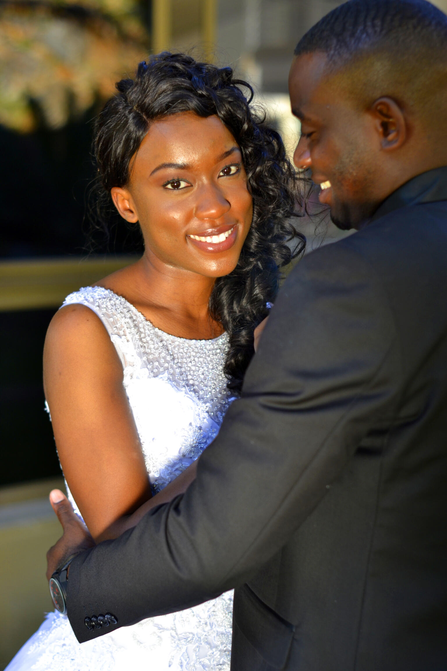Bride with groom smiling